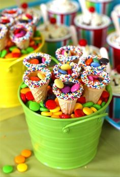 Rainbow party--every person gets a cone with rainbow sprinkles to fill from the candy bar?