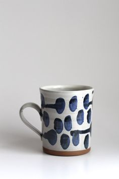 This listing is for one Polka-dot Mug. White with blue drippy dots on a dark brown stoneware clay. Mugs are a good size and can hold about 14 oz.  All