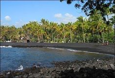 Punalu'u - black sand beach, Big Island, Hawaii.  Every inky basalt grain at Punalu'u is the result of lava from nearby Hawaii Volcanoes National Park exploding as it hits the ocean and cools. Not the best place for swimming, but the tradeoffs are the unique sights of coconut palms rising up from black sand and Hawaiian green sea turtles napping on the beach.