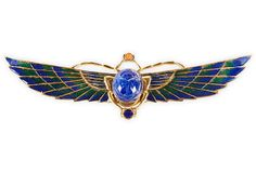 """Enamel Scarab Brooch -""""Art Deco enameled metal wing brooch with carved faux-lapis scarab cabochon. Circa 1930."""""""
