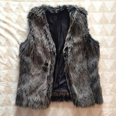 Faux Fur Vest Size S Faux Fur vest by INC. Size Small (runs small). Removed label in an attempt to make vest reversible. Black lining. INC International Concepts Jackets & Coats Vests