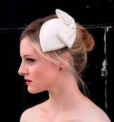 Ivory Teardrop Bridal Hat in Dutchesss Satin With Bow and Detachable Birdcage veil.1940s, 1950s, Fascinator. $210.00, via Etsy.