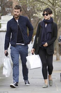 Jamie Dornan wearing Navy Suede Bomber Jacket, Black Crew-neck Sweater, White Crew-neck T-shirt, Blue Chinos White High Top Sneakers, White High Tops, Amelia Warner Jamie Dornan, Jamie Dornan And Wife, Most Stylish Men, Stylish Couple, Blue Chinos, Blue Trousers, Men Looks