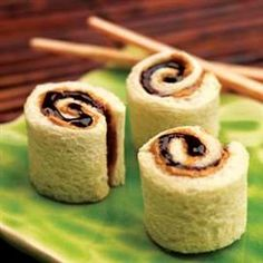 PB Sushi! 2 tablespoons Creamy Peanut Butter 2 tablespoons Strawberry Jelly, or any Jam, Jelly or Preserves of your choice 2 slices bread Directions: REMOVE crusts from bread. With a rolling pin or large soup can, completely flatten bread. SPREAD 1 tablespoon peanut butter and 1 tablespoon fruit spread on each slice of bread ROLL each slice into a tight spiral. Cut each spiral into 4 pieces.