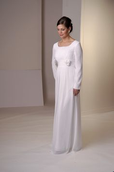 A modest Temple dress made in a soft crepe. The high waist and bodice have ruching.