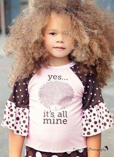 Cute little girl love her blond afro