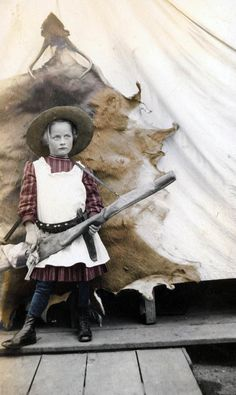 Prairie Girl by Animal pelt w Gun Rifle and Knife tinted fine art photograph.