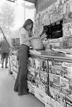 Jane Birkin buying newspapers in Paris, France.