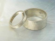earthy wedding ring set -- 18k white gold hand forged hammered wedding bands, satin finish. $2,232.00, via Etsy.
