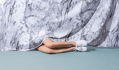 marble as draped fabric is fantastical, legs interacting in composition, placement is very graphic
