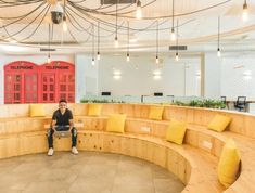 Retro Skype booths and a wooden amphitheatre create a dynamic space|||