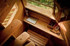 I would build my small desk area like this one simple with enough padded drawer space for a laptop when on the road