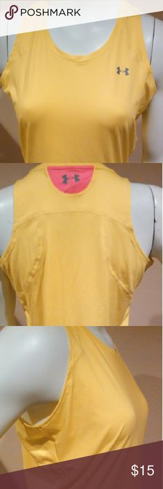 """Women's Under Armour Tank Top Jogging Shirt Yellow Women's Yellow Under Armour Heat Gear Tank Top Sleeveless Jogging Shirt Size Medium. 92% Polyester, 8% Elastane. Length from top to bottom: 25"""" measured while shirt was laid down flat. MSRP $29.99 Under Armour Tops Tank Tops"""