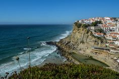 Azenhas do Mar, Sintra - A village by the sea - via Salt of Portugal 25.08.2013 | One of the prettiest village perchés in Portugal is Azenhas do Mar. Built on a cliff in the Colares region near Sintra, it has amazing views of the Atlantic ocean. If you rent a house in Azenhas do Mar, you can spend the day listening to the waves and watching the sea try different shades of blue and green. It's a very fine use of time.