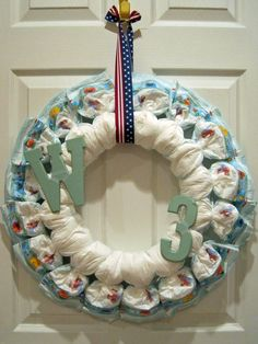 Diaper Wreath! Labor Day {gender neutral} themed BaByQ Diaper Shower for a friend's 3rd baby. Size 3 Pampers.