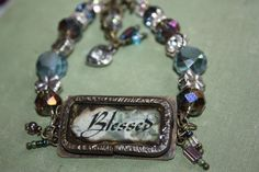 soldered metal inspirational bracelet using resin and burnt paper and upcycled belt pieces by CloverMoonDesigns on Etsy