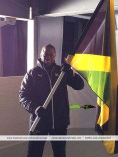 Flag bearer Marvin Dixon, the Jamaica Bobsled Team's brakeman, before stepping out at the Sochi 2014 Opening Ceremony.