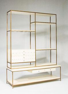 Love this sleek and modern shelving unit with build in drawes.  Brass and white furniture. Cabinet, bronze and white