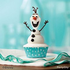 Olaf is here and he wants a warm hug! Almost too cute to eat, everything from Olaf's arms to his buttons, is edible! Yum! Click for our Olaf cupcake how-to!