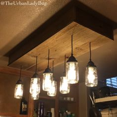 So incredibly proud of how this DIY light fixture turned out in our kitchen! Made out of Mason jars and refurbished fence wood from my dads backyard! My dad helped us with this awesome project! He made the wooden box and helped us with the electric wiring and mounting on the ceiling! Found this awesome idea off Pinterest and had to replace the awful 90s looking light fixture that was there before!! Came out better than we all could have imagined!