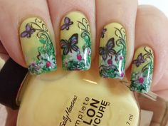 http://nailsit.blogspot.com/2012/04/sally-hansen-yellow-kitty-in-garden.html