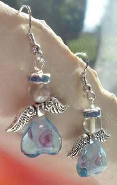 Sale  angel Earrings with heart shaped blue by Charsfavoritethings