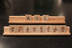 scrabble tiles with American Sign Language symbols laser engraved on the backs