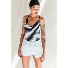 Urban Renewal Recycled Roll Hem Denim Short ($49) ❤ liked on Polyvore featuring shorts, short jean shorts, roll up shorts, white shorts, rolled shorts and vintage shorts