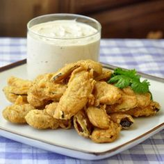 The Best Deep Fried Pickles with Homemade Chipotle Ranch Dip - These deep fried pickles were inspired by those found at the Penguin Diner in Charlotte, NC, with a warmly spiced, crispy batter & a creamy chipotle ranch dip. Rock Recipes, Great Recipes, Favorite Recipes, Delicious Recipes, Cake Recipes, I Love Food, Good Food, Yummy Food, Tasty