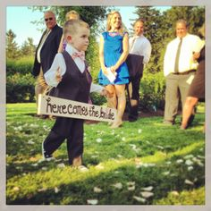 Any ring bearer sign can be flipped over to say just married as they walk back down the aisle together