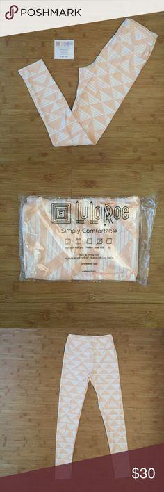 NWT OS Lularoe Peach Triangle Leggings Brand new in package. Beautiful peach color. LuLaRoe Pants Leggings