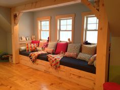 Custom bench seat/ window seat.  Two twin mattress size daybed. Creative playroom ideas. Scwcreativerenovations.com Playroom Seating, Playroom Ideas, Daybed, Log Homes, Man Cave, Mattress, Beach House, Home Improvement, Windows