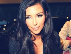 Probably my favorite picture of Kim. Love her hair and make up!