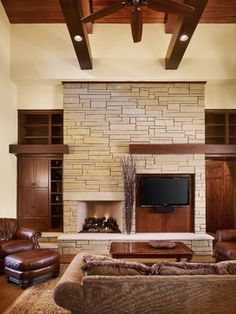 tv mounted high in space    Rocky River Living - contemporary - living room - austin - Cornerstone Architects