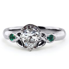 This beautiful take on the classic Irish Claddagh ring features an exquisite carat heart shaped diamond, flanked on either side by a Celtic love knot and emerald accents. Irish Engagement Rings, Irish Wedding Rings, Celebrity Engagement Rings, Wedding Rings Vintage, Engagement Ring Styles, Celtic Rings, Claddagh Rings, Celtic Love Knot, Heart Shaped Diamond