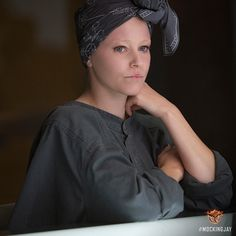 Elizabeth Banks shows you the woman behind the couture as Effie Trinket in The Hunger Games: Mockingjay Part 1.