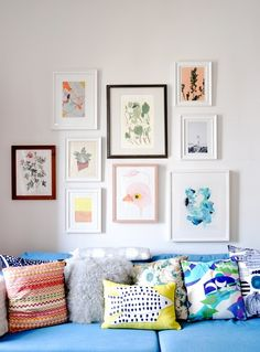 Cheery gallery wall & patterned pillows