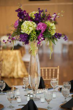 Tall Green and Purple Floral Centerpieces   Photo: Pottinger Photography   Arrangement: Pomp & Bloom  