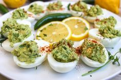 Guacamole Deviled Eggs - These would be fun as a healthy St Patrick's day food - green without food coloring!