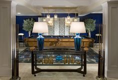 Designer Bradley Stephens featured Lacquered Strie 4563 Navy on walls, Woven Leather 4612 Putty on ceiling and Rings 5170 Navy on Ivory Manila Hemp on screen, in the game room of the 2010 Hampton Designer Showhouse. Pool table upholstered screen