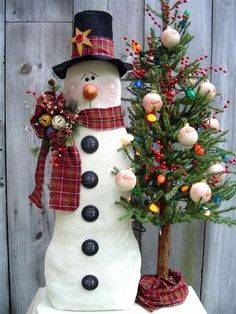 the snowman and his tree