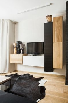 Moscow-based architectural studio SHKAF Architects designed the interior of a 46 square meter (approx. 495 square foot) flat in the town of Odintsovo for a young man who desired a neutral interior with African influences.