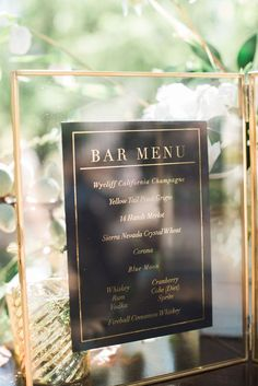 Love this wedding menu in a glass frame.