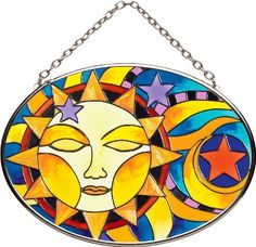 Joan Baker Designs  SO283 Sun Art Glass Suncatcher, 4-1/2-Inch by 3-1/4-Inch by Joan Baker Designs. $11.03. Hand-painted. Translucent artwork looks beautiful from inside or outside the window. Nickle-plated frame and chain for lead free, longlasting beauty. Small in size but big on pretty, these hand-painted art glass Suncatchers perk up any window with a splash of color and appealing design.   For more than 40 years, Joan Baker Designs' talented artisans have created st...