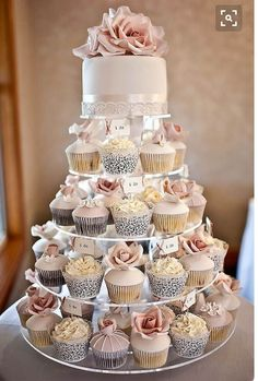 Love a Cupcake Wedding Cake! Never any leftovers and a tier to take home and share with family. @tedbaker #WedWithTed