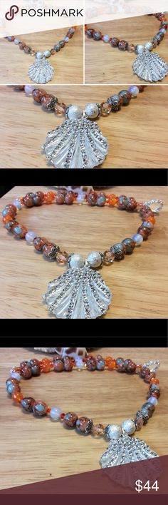 Boho beach style necklace New without tags. This gorgeous bohemian beach style necklace features 10mm mosaic Jade beads along with 8mm orange glass rounds and moonlight beads. It also features a beautiful crystallized shell pendant with has two silver stardust beads on each size. It will s fished off with a silver toned toggle clasp handmade Jewelry Necklaces