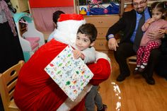 Santa giving out presents at the LAU ECC Christmas event