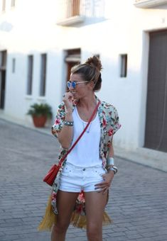 Layered look with white shorts, white tank top and floral shirt
