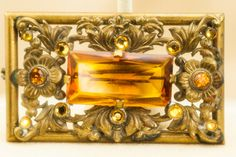 Beautiful 1930s-40s Czech brooch with striking amber colored faceted stones. Brooch measures 2.5 x 1.5 inches In excellent condition .