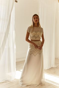 Avery Two Piece Wedding Look by Bo and Luca   This Silk Chiffon two-piece gown has been designed for the bride who's ready to dance the night away. A playful alternative to a traditional gown, this piece features a hand-beaded zig zag design that catches the light. The skirt is designed to be worn on the waist, while the top is designed to be worn fitted and cropped.